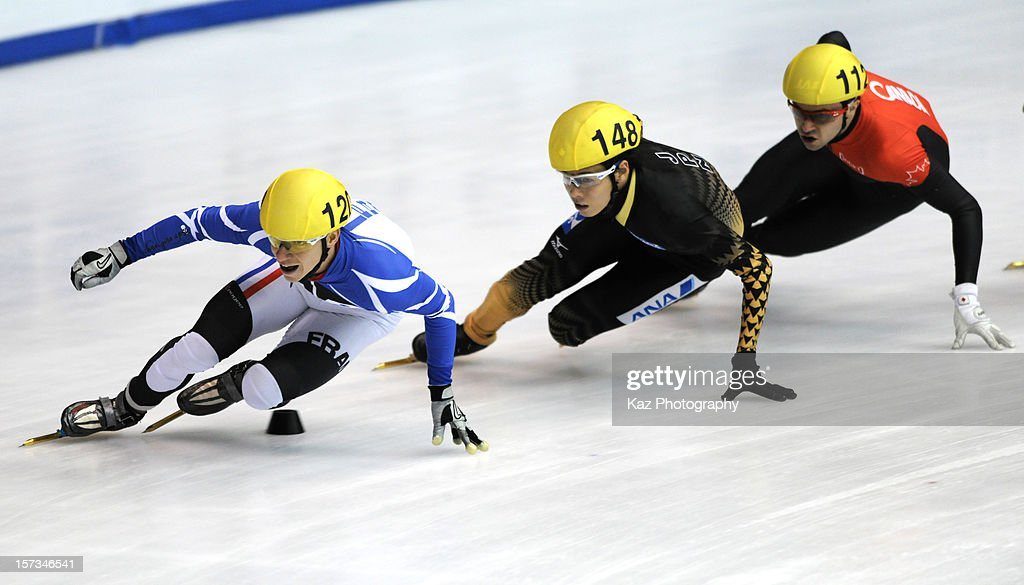 <a gi-track='captionPersonalityLinkClicked' href=/galleries/search?phrase=Maxime+Chataignier&family=editorial&specificpeople=504686 ng-click='$event.stopPropagation()'>Maxime Chataignier</a> of France followed by <a gi-track='captionPersonalityLinkClicked' href=/galleries/search?phrase=Yuzo+Takamido&family=editorial&specificpeople=4876407 ng-click='$event.stopPropagation()'>Yuzo Takamido</a> of Japan and Liam Mcfarlane of Canada in Final B of Men 1500m(2) during day three of the ISU World Cup Short Track at Nippon Gaishi Arena on December 2, 2012 in Nagoya, Japan.