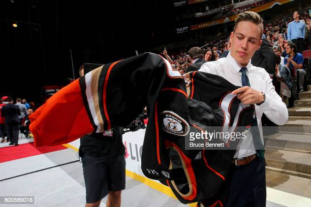 Maxime Comtois puts on the Anaheim Ducks jersey after being selected 50th overall during the 2017 NHL Draft at the United Center on June 24 2017 in...