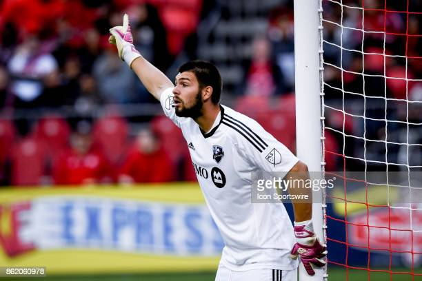 Maxime Crépeau of Montreal Impact gives his team instructions during the first half of the MLS Soccer regular season game between Toronto FC and...