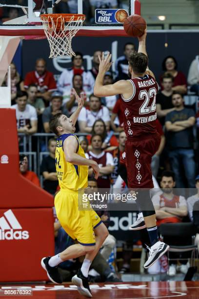 Maxime de Zeeuw of Oldenburg and Danilo Barthel of Bayern Muenchen battle for the ball during the easyCredit BBL Basketball Bundesliga match between...