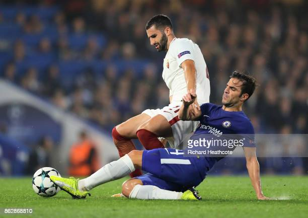 Maxime Gonalons of AS Roma and Cesc Fabregas of Chelsea battle for possession during the UEFA Champions League group C match between Chelsea FC and...