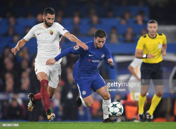 Maxime Gonalons of AS Roma and Eden Hazard of Chelsea battle for possession during the UEFA Champions League group C match between Chelsea FC and AS...