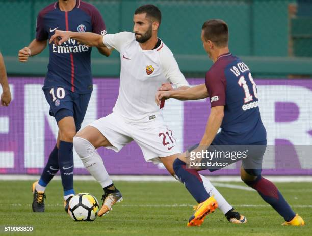 Maxime Gonalons of AS Roma tries to break away from Giovani Lo Celso of Paris SaintGermain during the first half at Comerica Park on July 19 2017 in...