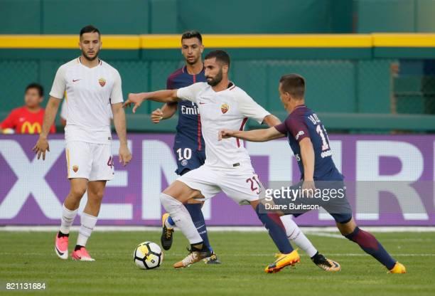 Maxime Gonalons of AS Roma tries to break away from Giovani Lo Celso of Paris SaintGermain as Kostas Manolas of AS Roma and Javier Pastore of Paris...