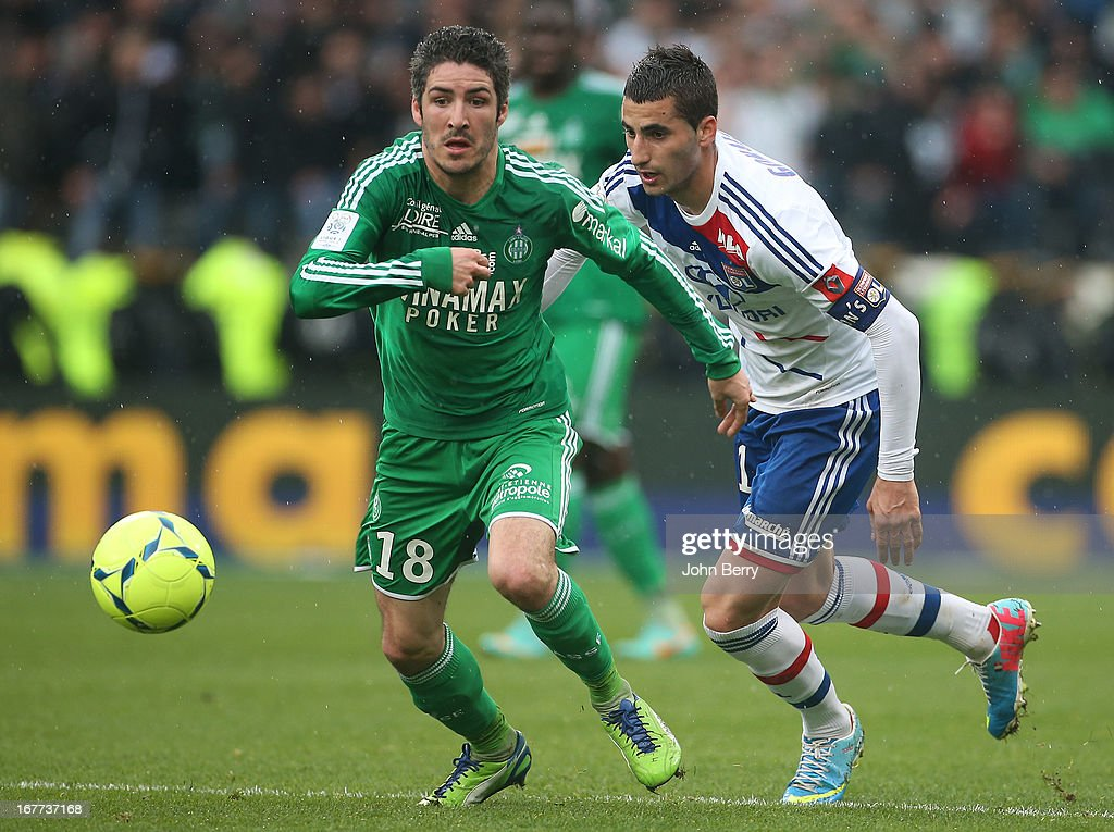 Maxime Gonalons of Lyon and Fabien Lemoine of Saint-Etienne (L) in action during the Ligue 1 match between Olympique Lyonnais, OL, and AS Saint-Etienne, ASSE, at the Stade Gerland on April 28, 2013 in Lyon, France.