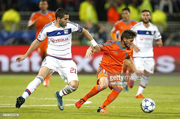 Maxime Gonalons of Lyon and Pablo Piatti of Valencia CF in action during the UEFA Champions league match between Olympic Lyonnais and Valencia CF at...