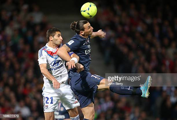 Maxime Gonalons of Lyon and Zlatan Ibrahimovic of PSG in action during the Ligue 1 match between Olympique Lyonnais OL and Paris SaintGermain FC PSG...