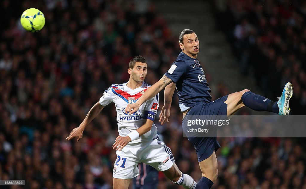 <a gi-track='captionPersonalityLinkClicked' href=/galleries/search?phrase=Maxime+Gonalons&family=editorial&specificpeople=6256905 ng-click='$event.stopPropagation()'>Maxime Gonalons</a> of Lyon and <a gi-track='captionPersonalityLinkClicked' href=/galleries/search?phrase=Zlatan+Ibrahimovic&family=editorial&specificpeople=206139 ng-click='$event.stopPropagation()'>Zlatan Ibrahimovic</a> of PSG in action during the Ligue 1 match between Olympique Lyonnais, OL, and Paris Saint-Germain FC, PSG, at the Stade Gerland on May 12, 2013 in Lyon, France.
