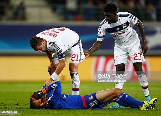 Maxime Gonalons of Lyon checks on his team mate Goalkeeper Anthony Lopes after he goes down holding his face during the UEFA Champions League Group H...