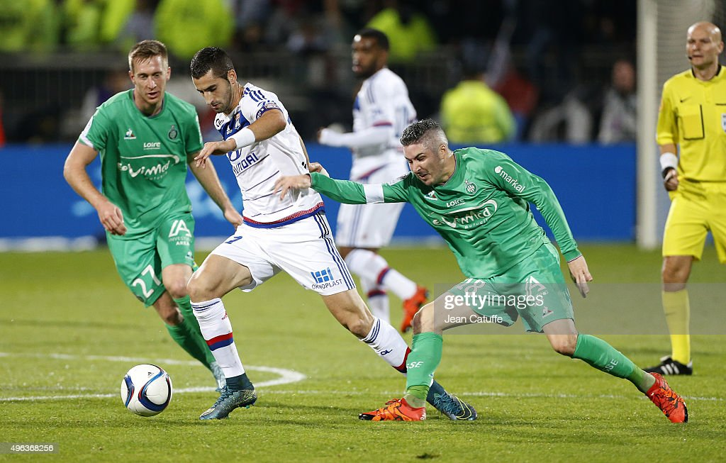 Maxime Gonalons of Lyon in action between Robert Beric and Fabien Lemoine of Saint-Etienne during the French Ligue 1 match between Olympique Lyonnais (OL) and AS Saint-Etienne (ASSE) at Stade de Gerland on November 8, 2015 in Lyon, France.