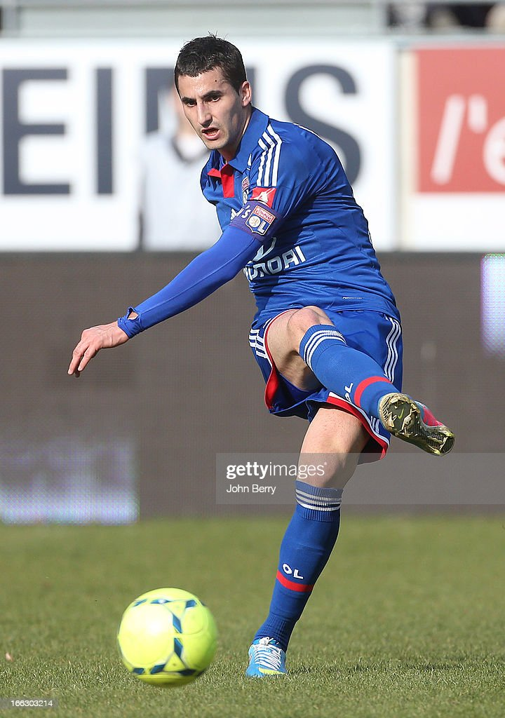 <a gi-track='captionPersonalityLinkClicked' href=/galleries/search?phrase=Maxime+Gonalons&family=editorial&specificpeople=6256905 ng-click='$event.stopPropagation()'>Maxime Gonalons</a> of Lyon in action during the french Ligue 1 match between Stade de Reims and Olympique Lyonnais, OL, at the Stade Auguste Delaune on April 7, 2013 in Reims, France.