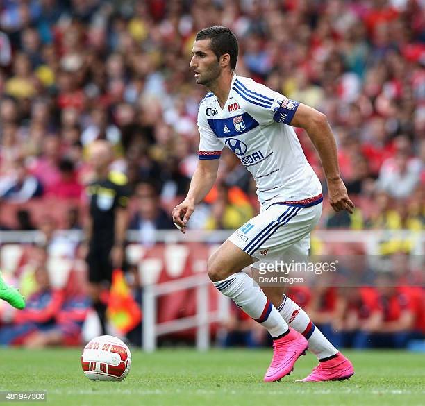 Maxime Gonalons of Lyon runs with the ball during the Emirates Cup match between Arsenal and Olympique Lyonnais at the Emirates Stadium on July 25...