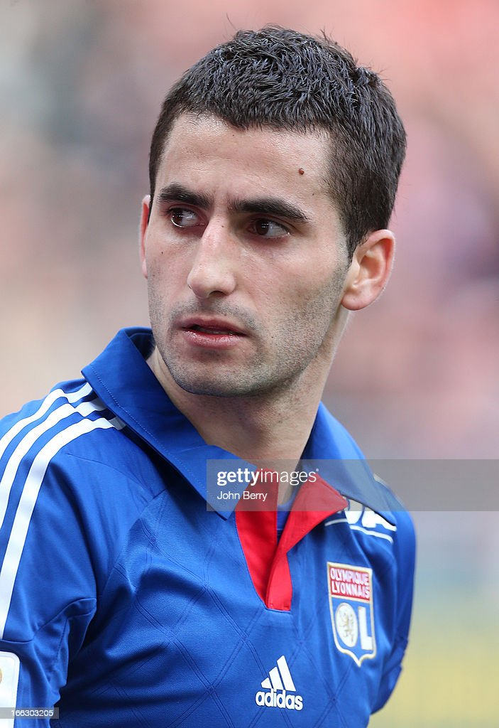 <a gi-track='captionPersonalityLinkClicked' href=/galleries/search?phrase=Maxime+Gonalons&family=editorial&specificpeople=6256905 ng-click='$event.stopPropagation()'>Maxime Gonalons</a> of Lyon salutes the supporters of his team at the end of the french Ligue 1 match between Stade de Reims and Olympique Lyonnais, OL, at the Stade Auguste Delaune on April 7, 2013 in Reims, France.
