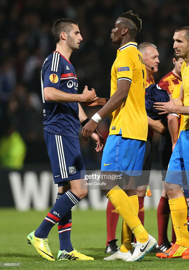 <a gi-track='captionPersonalityLinkClicked' href=/galleries/search?phrase=Maxime+Gonalons&family=editorial&specificpeople=6256905 ng-click='$event.stopPropagation()'>Maxime Gonalons</a> of Lyon shakes hands with <a gi-track='captionPersonalityLinkClicked' href=/galleries/search?phrase=Paul+Pogba&family=editorial&specificpeople=5805302 ng-click='$event.stopPropagation()'>Paul Pogba</a> of Juventus Turin at the end of the UEFA Europa League quarter final match between Olympique Lyonnais OL and Juventus Turin at Stade de Gerland on April 3, 2014 in Lyon, France.