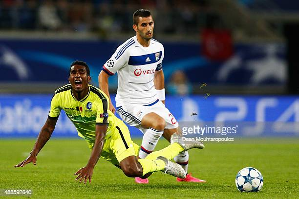Maxime Gonalons of Lyon tackles Renato Cardoso Neto of Gent during the UEFA Champions League Group H match between KAA Gent and Olympique Lyonnais...