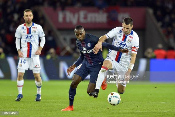 Maxime Gonalons of Olympique Lyonnais and Blaise Matuidi of Paris SaintGermain fight for the ball during the French Ligue 1 match between Paris Saint...