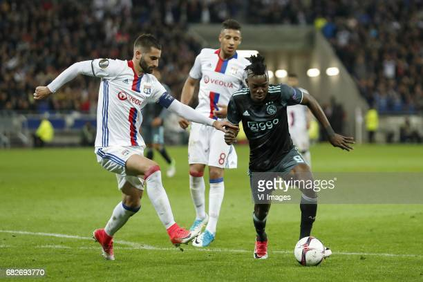 Maxime Gonalons of Olympique Lyonnais Corentin Tolisso of Olympique Lyonnais Bertrand Traore of Ajaxduring the UEFA Europa League semi final match...