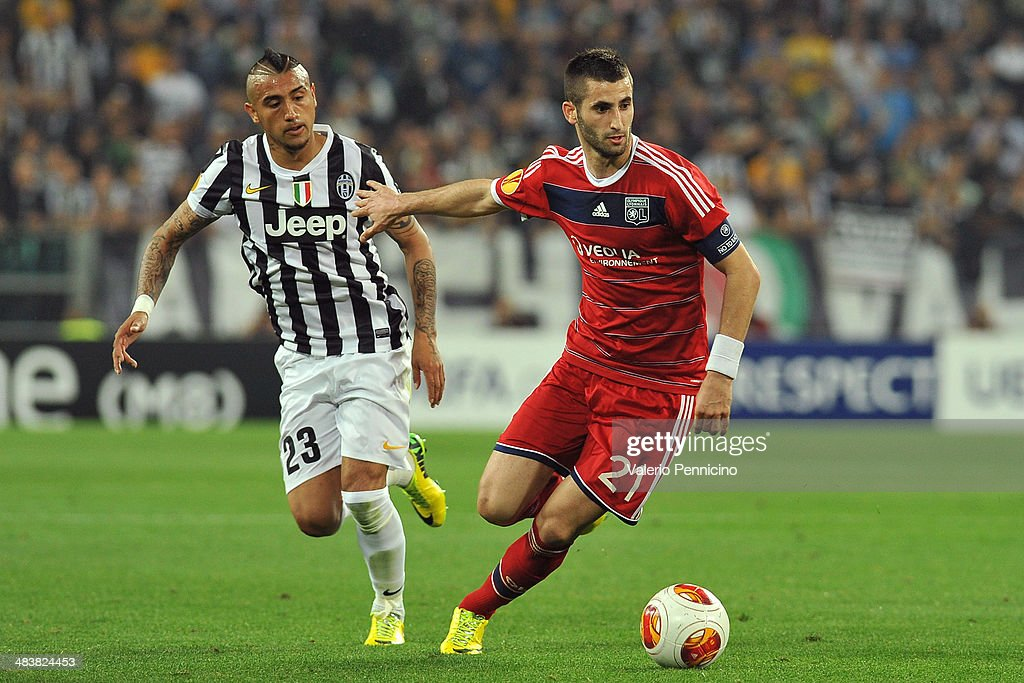 Maxime Gonalons (R) of Olympique Lyonnais in action against Arturo Vidal of Juventus during the UEFA Europa League quarter final match between Juventus and Olympique Lyonnais at Juventus Arena on April 10, 2014 in Turin, Italy.