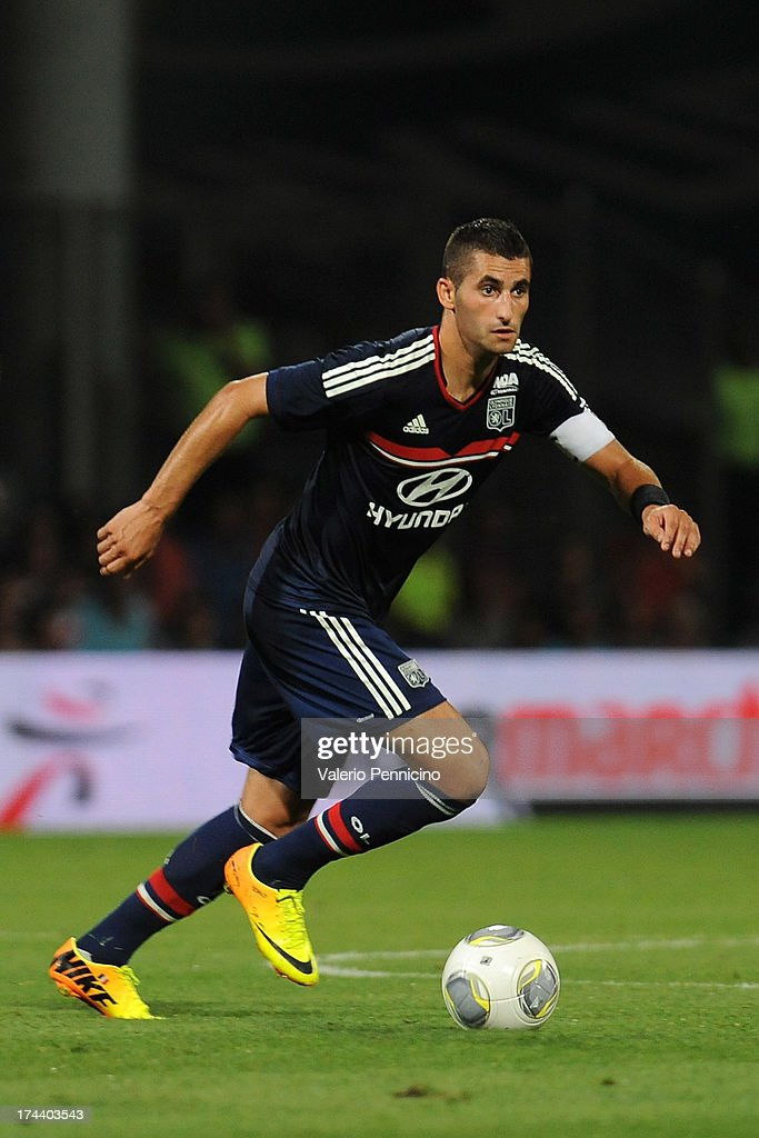 <a gi-track='captionPersonalityLinkClicked' href=/galleries/search?phrase=Maxime+Gonalons&family=editorial&specificpeople=6256905 ng-click='$event.stopPropagation()'>Maxime Gonalons</a> of Olympique Lyonnais in action during the Pre Season match between Olympique Lyonnais and Real Madrid at Gerland Stadium on July 24, 2013 in Lyon, France.