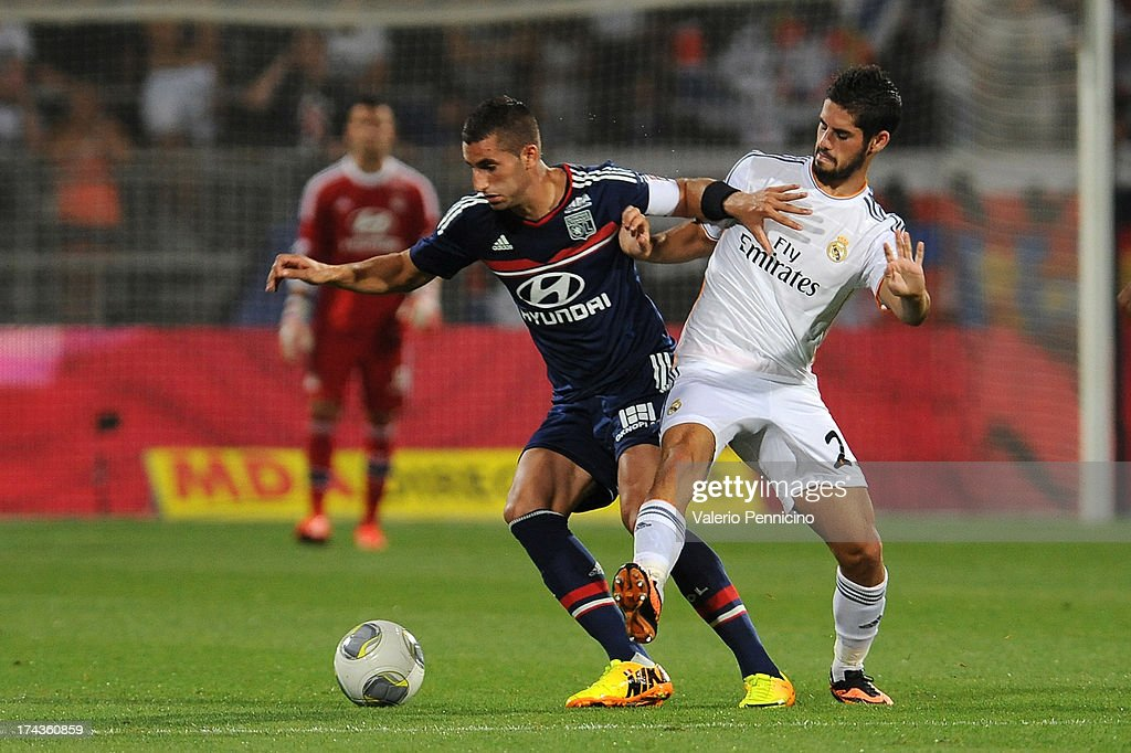 <a gi-track='captionPersonalityLinkClicked' href=/galleries/search?phrase=Maxime+Gonalons&family=editorial&specificpeople=6256905 ng-click='$event.stopPropagation()'>Maxime Gonalons</a> (L) of Olympique Lyonnais is challenged by Isco of Real Madrid during the Pre Season match between Olympique Lyonnais and Real Madrid at Gerland Stadium on July 24, 2013 in Lyon, France.