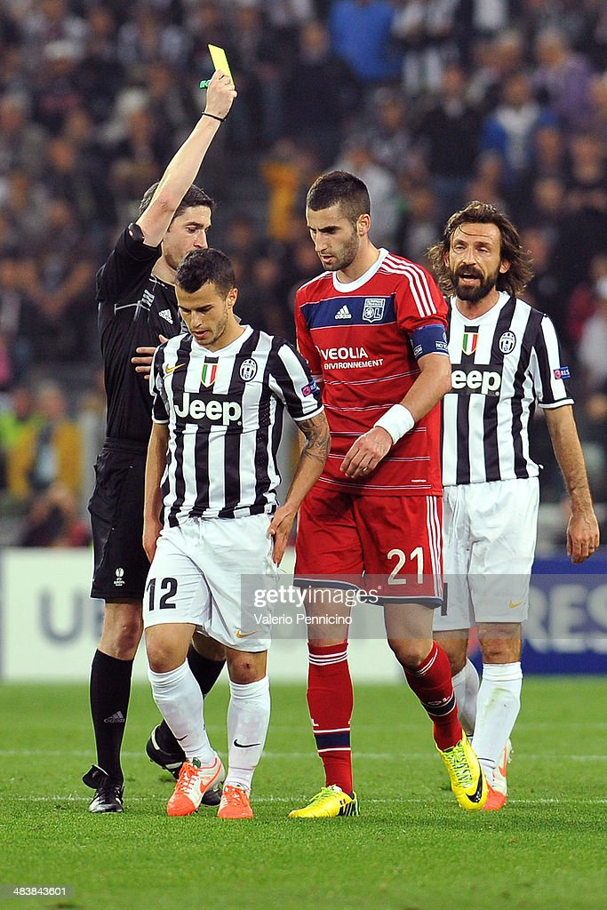 Maxime Gonalons (C) of Olympique Lyonnais receives the yellow card from referee Alberto Mallenco of Spain durig the UEFA Europa League quarter final match between Juventus and Olympique Lyonnais at Juventus Arena on April 10, 2014 in Turin, Italy.