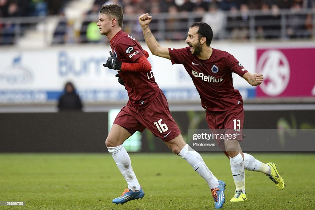 Maxime Lestienne of Club Brugge celebrates with Victor Vazquez of Club Brugge after scoring during the Jupiler League match between KAA Gent and Club Brugge on December 22, 2013 at the Ghelamco arena in Gent, Belgium.