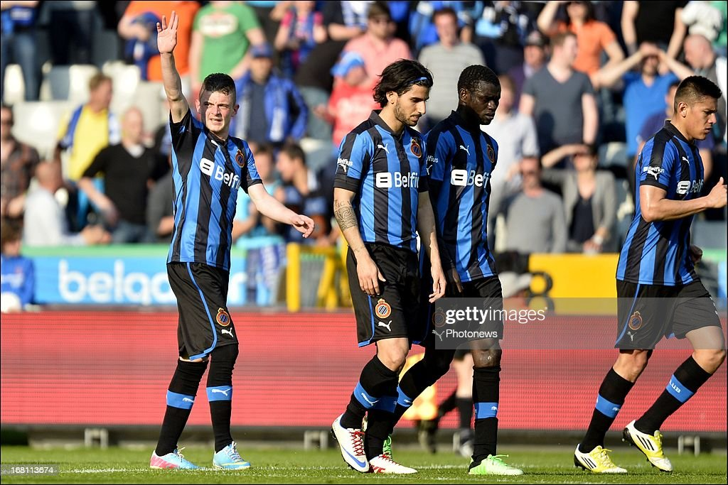 Maxime Lestienne (L) of Club Brugge KV celebrates after scoring a goal during the Jupiler Pro League play-off 1 match between Club Brugge and Sporting Lokeren on May 5, 2013 in Brugge, Belgium.