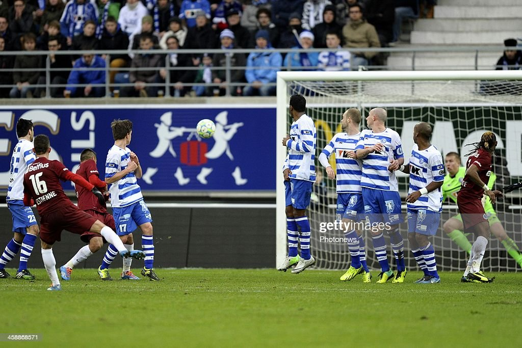 Maxime Lestienne of Club Brugge scores a goal from a freekick during the Jupiler League match between KAA Gent and Club Brugge on December 22, 2013 at the Ghelamco arena in Gent, Belgium.
