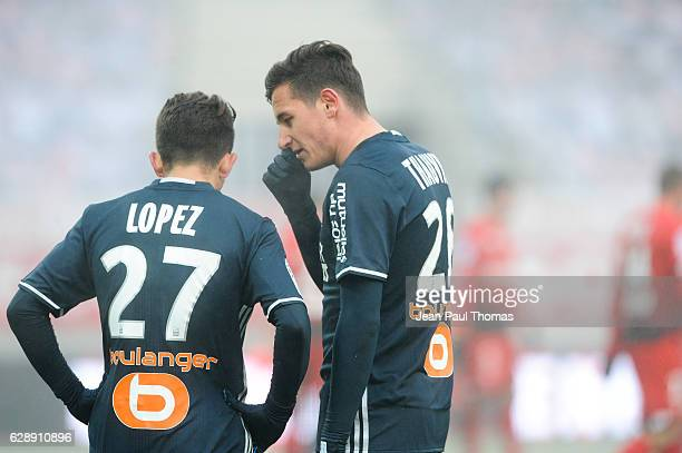 Maxime LOPEZ and Florian THAUVIN of Marseille during the French Ligue 1 between Dijon and Marseille at Stade Gaston Gerard on December 10 2016 in...
