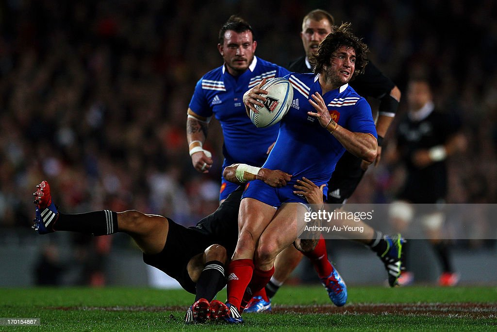 <a gi-track='captionPersonalityLinkClicked' href=/galleries/search?phrase=Maxime+Machenaud&family=editorial&specificpeople=7149115 ng-click='$event.stopPropagation()'>Maxime Machenaud</a> of France is tackled by Aaron Smith of New Zealand during the first test match between the New Zealand All Blacks and France at Eden Park on June 8, 2013 in Auckland, New Zealand.