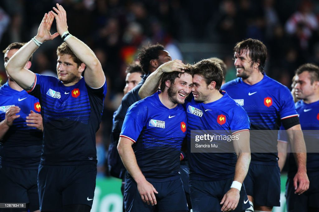Maxime Medard C) <a gi-track='captionPersonalityLinkClicked' href=/galleries/search?phrase=Vincent+Clerc&family=editorial&specificpeople=235795 ng-click='$event.stopPropagation()'>Vincent Clerc</a> of France celebrate victory after the quarter final two of the 2011 IRB Rugby World Cup between England and France at Eden Park on October 8, 2011 in Auckland, New Zealand.