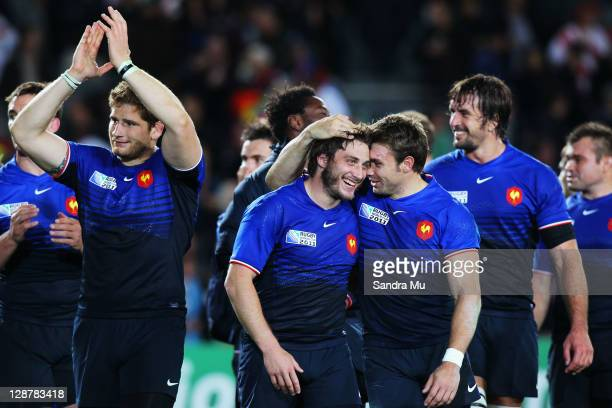 Maxime Medard C Vincent Clerc of France celebrate victory after the quarter final two of the 2011 IRB Rugby World Cup between England and France at...