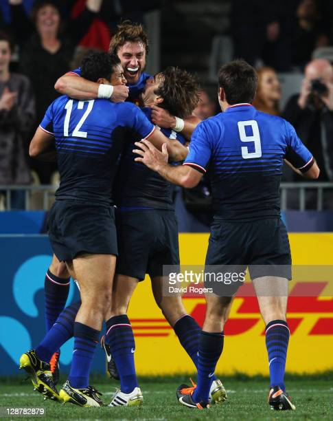 Maxime Medard of France celebrates his try with team mates during quarter final two of the 2011 IRB Rugby World Cup between England and France at...
