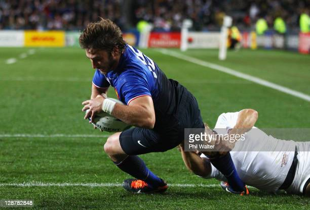 Maxime Medard of France goes over to score his teams second try during quarter final two of the 2011 IRB Rugby World Cup between England and France...