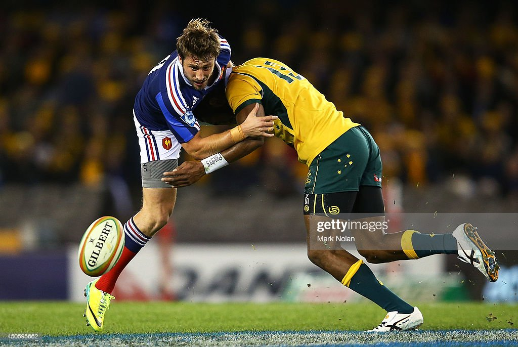 Maxime Medard of France is tackled by <a gi-track='captionPersonalityLinkClicked' href=/galleries/search?phrase=Tevita+Kuridrani&family=editorial&specificpeople=7612194 ng-click='$event.stopPropagation()'>Tevita Kuridrani</a> of the Wallabiesduring the second International Test Match between the Australian Wallabies and France at Etihad Stadium on June 14, 2014 in Melbourne, Australia.