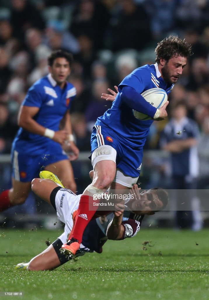<a gi-track='captionPersonalityLinkClicked' href=/galleries/search?phrase=Maxime+Medard&family=editorial&specificpeople=832902 ng-click='$event.stopPropagation()'>Maxime Medard</a> of France is tackled during the tour match between the Auckland Blues and France at North Harbour Stadium on June 11, 2013 in Auckland, New Zealand.