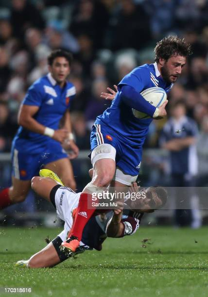 Maxime Medard of France is tackled during the tour match between the Auckland Blues and France at North Harbour Stadium on June 11 2013 in Auckland...
