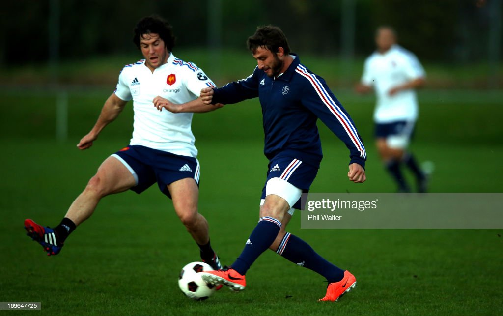 <a gi-track='captionPersonalityLinkClicked' href=/galleries/search?phrase=Maxime+Medard&family=editorial&specificpeople=832902 ng-click='$event.stopPropagation()'>Maxime Medard</a> of France kicks a football during a France rugby training session at Onewa Domain on May 30, 2013 in Takapuna, New Zealand.