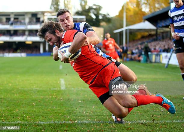 Maxime Medard of Toulouse holds off the challenge of George Ford of Bath to score a try during the European Rugby Champions Cup match between Bath...