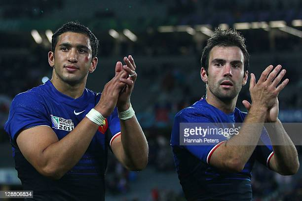 Maxime Mermoz and Morgan Parra of France celebrate victory after quarter final two of the 2011 IRB Rugby World Cup between England and France at Eden...
