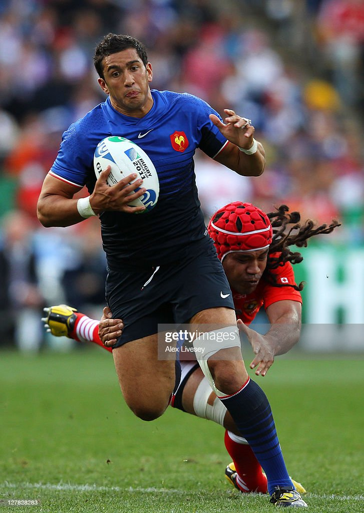 Maxime Mermoz of France escapes the tackle from Paino Hehea of Tonga during the IRB 2011 Rugby World Cup Pool A match between France and Tonga at Wellington Regional Stadium on October 1, 2011 in Wellington, New Zealand.