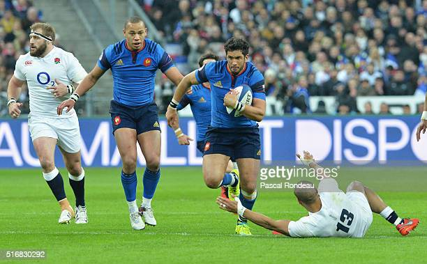 Maxime Mermoz of France goes past Jonathan Joseph of England during the RBS Six Nations match between France and England at Stade de France on March...
