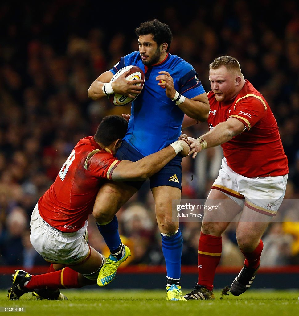 <a gi-track='captionPersonalityLinkClicked' href=/galleries/search?phrase=Maxime+Mermoz&family=editorial&specificpeople=561871 ng-click='$event.stopPropagation()'>Maxime Mermoz</a> of France is tackled by <a gi-track='captionPersonalityLinkClicked' href=/galleries/search?phrase=Taulupe+Faletau&family=editorial&specificpeople=12444794 ng-click='$event.stopPropagation()'>Taulupe Faletau</a> and Samson Lee of Wales during the RBS Six Nations match between Wales and France at the Principality Stadium on February 26, 2016 in Cardiff, Wales.