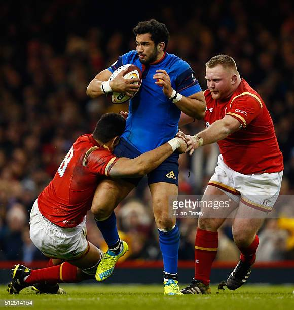 Maxime Mermoz of France is tackled by Taulupe Faletau and Samson Lee of Wales during the RBS Six Nations match between Wales and France at the...