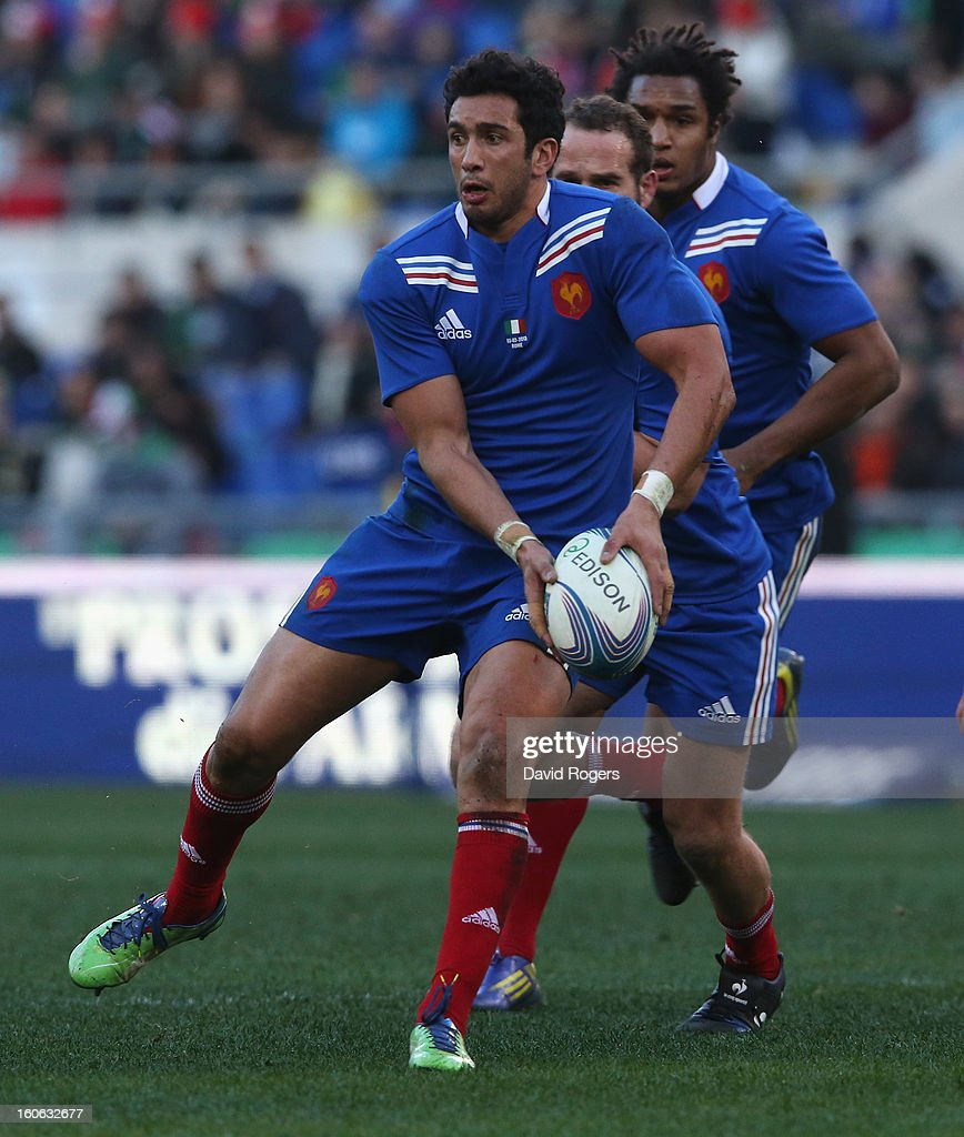 Maxime Mermoz of France passes the ball during the RBS Six Nations match between Italy and France at Stadio Olimpico on February 3, 2013 in Rome, Italy.