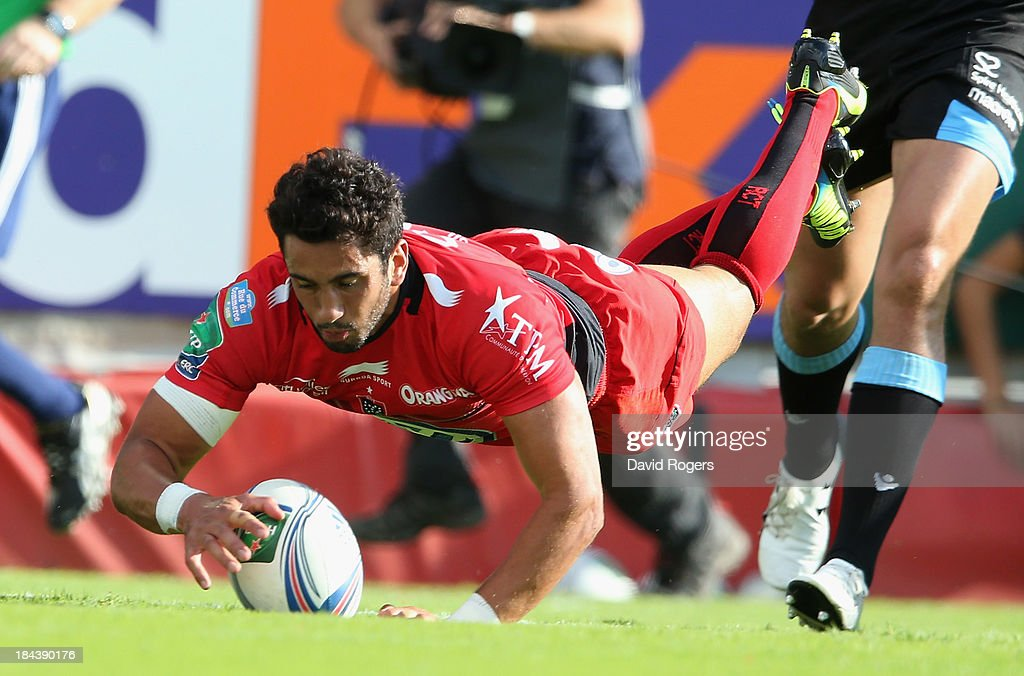 Maxime Mermoz of Toulon dives over for his first try during the Heineken Cup Pool 2 match between Toulon and Glasgow Warriors at the Felix Mayol Stadium on October 13, 2013 in Toulon, France.