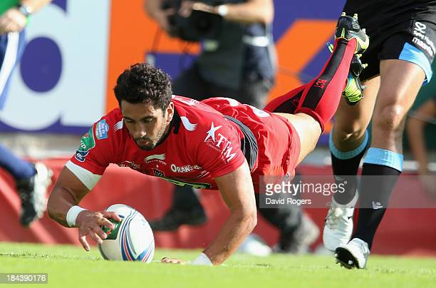 Maxime Mermoz of Toulon dives over for his first try during the Heineken Cup Pool 2 match between Toulon and Glasgow Warriors at the Felix Mayol...