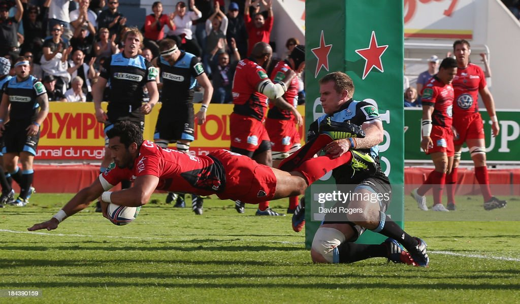 Maxime Mermoz of Toulon dives over for his second try during the Heineken Cup Pool 2 match between Toulon and Glasgow Warriors at the Felix Mayol Stadium on October 13, 2013 in Toulon, France.