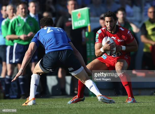 Maxime Mermoz of Toulon runs with the ball during the Heineken Cup quarter final match between Toulon and Leinster at the Felix Mayol Stadium on...