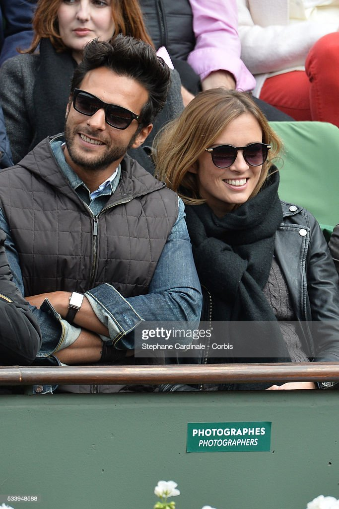 Maxime Nucci and Isabelle Ithurburu at Roland Garros on May 24, 2016 in Paris, France.